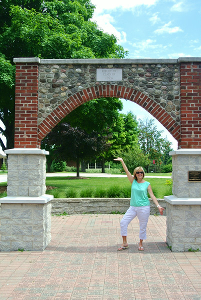 Judy under the Brick & Stone Arch, her class renovated in 1974