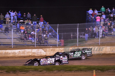 29 Darrell Lanigan and 20 Jimmy Owens battle for the lead.