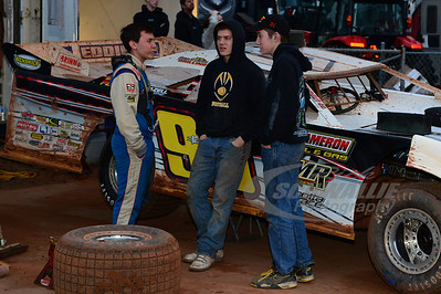 Devin Moran talks with crew member Tristin Moran (center) and Crew Chief Wylie Moran (right)