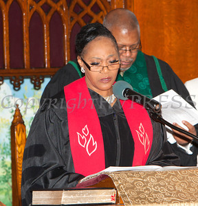 Baptist Temple Associate Minister Dr. Dollyann Newkirk-Briggs offers the Memorial of Silence at the Christian Ministerial Fellowship of Newburgh & Vicinity's 45th Annual Martin Luther King Jr Celebration on Wednesday, January 15, 2014 at Baptist Temple Church in Newburgh, NY. Hudson Valley Press/CHUCK STEWART, JR.