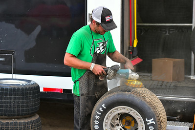 Jason Feger crew member grinds a tire for competition that night