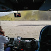 """Since Sammi and I turned back and weren't hiking to Thorsmork we decided we'd take the bus there and meet the rest of the crew so we could spend the night. The bus had an automated system to tell the riders what you were seeing, assuming it wasn't completely fogged in (we couldn't see a thing). They told us that the road is accessible by 4x4 until the last river crossing, at which point only the bus can cross. <br /> <br /> We got to this river and were told to get out and check the river. Sometimes it's a trickle and other times a torrent. Since it had rained all day we assumed it would be a nice little river. We didn't see a thing. Confused, we got back on the bus and it drove another 40m, to HERE. HOLY COW! """"We're CROSSING *THAT*?!?!?!""""*<br /> <br /> We assumed the driver was on the phone with his wife, to tell her he loved her. Turns out he was talking to a guy with a giant tractor who came to find the deep spots. The driver gunned it across and we made it safe and sound!"""