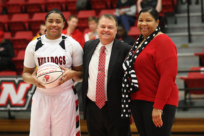 Catrina Green receives a game ball to honor her 1000th shot of her career