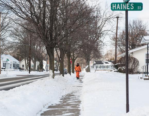 140128 3A Ent JOED VIERA/STAFF PHOTOGRAPHER Lockport, NY- A man walks through the subzero windchills on Beattie Ave on Tuesday, January 28th.