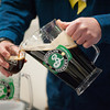 140125 Beer JOED VIERA/STAFF PHOTOGRAPHER Lockport,NY-Joe Dimaria pours Brooklyn Brewery's Irish Stout at the beer and wine tasting eventheld at the Kenan Center Saturday, January 25th.