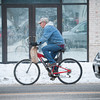 140129 3A Ent JOED VIERA/STAFF PHOTOGRAPHER Lockport, NY- A man rides his bike on Walnut St. on Monday, January 29th.