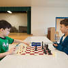 131230 Upton Chess JOED VIERA/STAFF PHOTOGRAPHER Lockport, NY-Upson Elementary chess players Andrew O'Dell(left) and  JonLuke Pencille(right)play a game of chess after the Upson's beginers chess championship on Monday Dec 30th, 2013. O'dell placed 2nd in the K-2 division and Pencille won the championship in the K-1 division.