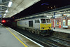 28 January 2014 :: Making its first visit to Basingstoke since being repainted into this Drax grey livery, 60066 passes through the station with 6O42 loaded cars from Halewood to Southampton