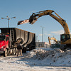 140103 Lockport Ice Arena JOED VIERA/STAFF PHOTOGRAPHER Lockport, NY-An excavator dumps a steel beam from the demolition site of the old Lockport ice arena Friday Jan 2nd, 2013..