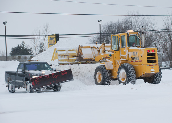 140125 3A Ent JOED VIERA/STAFF PHOTOGRAPHER Lockport, NY- Trucks plow a parking lot on Transit Road on Saturday, January 25th.