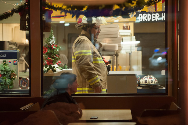 131220 Masterpiece fire JOED VIERA/STAFF PHOTOGRAPHER Lockport, NY-First Assistant Chief of the South Lockport volunteer firefighters Tim Glaser surveys the damage done by a grease fire at Masterpiece Pizza on Friday Dec 20th, 2013.