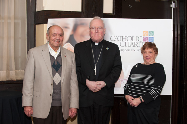 140129 Catholic charities JOED VIERA/STAFF PHOTOGRAPHER Lockport, NY- Catholic Charities Co-Chairman Richard Scinta (left) and All Saints Parish's Rachel Dagostino (right) stand with Bishop of the Diocese of Buffalo Richard J. Malone at the 2014 Catholic Charities Appeal workshop held at the Tuscorora Inn on Monday, January 29th.