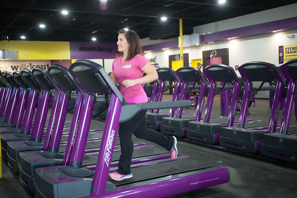 140112 Planet Fitness JOED VIERA/STAFF PHOTOGRAPHER Lockport,NY- Danni Allen wInner of the biggest loser uses a treadmill to run at Planet Fitness on Monday.