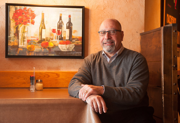 140122 Village Eatery JOED VIERA/STAFF PHOTOGRAPHER Lockport,NY-Restaurant owner Peter Calieri sits at a table at the Village Eatery on Monday, January 22nd. Calieri's restaurant recently celebrated their 35th year of being open on December 26th.