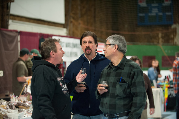 140125 Beer JOED VIERA/STAFF PHOTOGRAPHER Lockport,NY- Friends Ed Bachman(left), Jim Kotos (center) and Blaine Wegrzynowski (right) enjoy a sample of Hamburg Brewing Company's beer at the beer and wine tasting event held at the Kenan Center Saturday, January 25th.