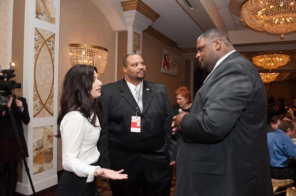 140131 GOP JOED VIERA/STAFF PHOTOGRAPHER Lockport ,NY-Jennifer D. D'Andrea-Terreri and Pete Robinson Chairman City of Lockport Republican Committee  speaks with NFTA hero Darnell Barton on January 31st, 2014.