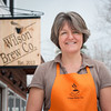 131226 Wilson Brew CoJOED VIERA/STAFF PHOTOGRAPHER Wilson, NY-Anne Daul owner of the Wilson Brew Co. stands outside of her business on Thursday Dec 26th, 2013. The coffee shop celebrated thier grand opening on December 15th.