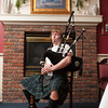 140110 Burns Dinner JOED VIERA/STAFF PHOTOGRAPHER Wilson,NY-Evan Keefer sits down and plays his bagpipe at the Wilson House Restaurant on Thursday.