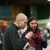 140125 Beer JOED VIERA/STAFF PHOTOGRAPHER Lockport,NY- Kristin Lee and Justin Durke have a sample from the Midnight Run Wine Cellars booth at the beer and wine tasting event held at the Kenan Center Saturday, January 25th.