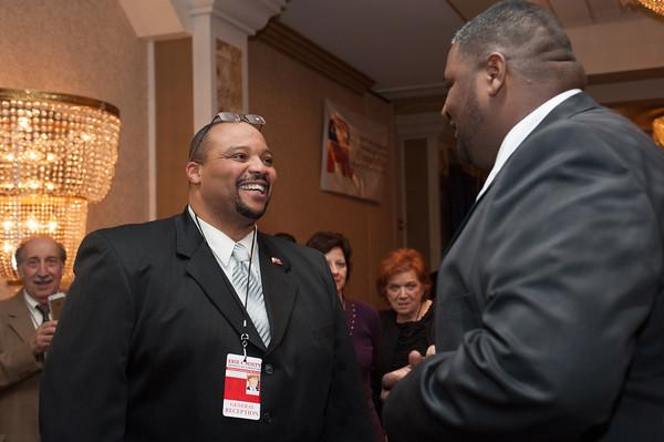 140131 GOP JOED VIERA/STAFF PHOTOGRAPHER Lockport ,NY-Pete Robinson Chairman City of Lockport Republican Committee  speaks with NFTA hero Darnell Barton on January 31st, 2014.