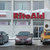 140128 3A Ent JOED VIERA/STAFF PHOTOGRAPHER Lockport, NY- Snow covers the sign of the Rite Aid on East Ave. on Tuesday, January 28th.