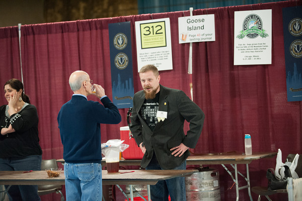 140125 Beer JOED VIERA/STAFF PHOTOGRAPHER Lockport,NY- Dan Baish talks with Joe Zurlo as he has a taste of Goose Island's Pale Ale at the beer and wine tasting event held at the Kenan Center Saturday, January 25th.
