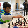 131230 Upton Chess JOED VIERA/STAFF PHOTOGRAPHER Lockport, NY-St. Gregory's student Ashton Williams plays a friendly game of chess after Upson's beginners chess championship on Monday Dec 30th, 2013. Williams won the championship in the K-2 division making it his 39th trophy.
