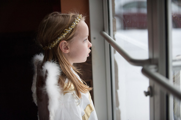 131224 Christmas Pageant JOED VIERA/STAFF PHOTOGRAPHER Lockport, NY-Victoria Mendetta(7) dressed as an angel looks outside from inside of All Saints Church before performing in  this years Christmas Eve pageant on Tuesday Dec 24th, 2013.