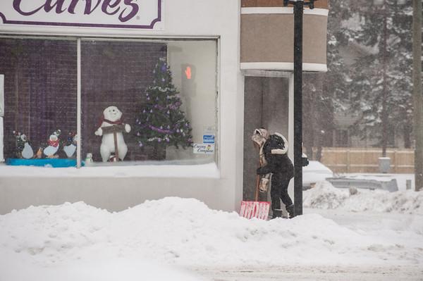 140102 Winter Enterprise JOED VIERA/STAFF PHOTOGRAPHER Lockport, NY-A woman shovels  a side walk on Walnut St Thursday Jan 2nd, 2013.