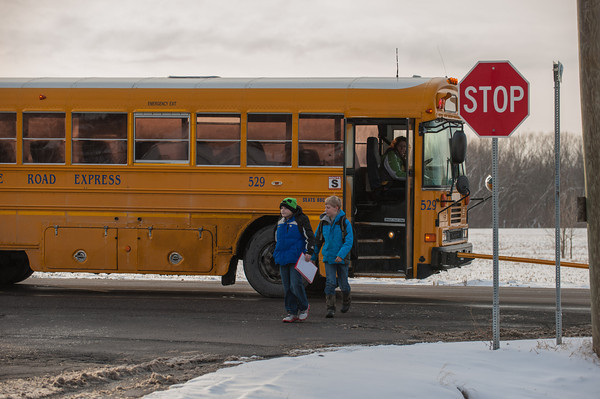 140122 young rd JOED VIERA/STAFF PHOTOGRAPHER Lockport,NY-A school bus drops students off at the corner of Young Road and Sunset Blvd on Monday, January 22nd.