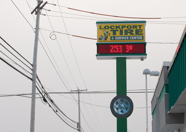 140107 3a Ent JOED VIERA/STAFF PHOTOGRAPHER Lockport,NY-The sign on Lockport Tire & Service Center's displays the blistering cold temperature of 3 degrees Tuesday Jan 7th, 2014.