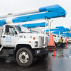 131220 3A Ent JOED VIERA/STAFF PHOTOGRAPHER Lockport, NY-A fleet of MTV Solutions utility trucks are parked at Cammarata's Restaurant as drivers grab a meal before heading out to repair damages caused by Sunday's storm on Monday Dec 23rd, 2013.