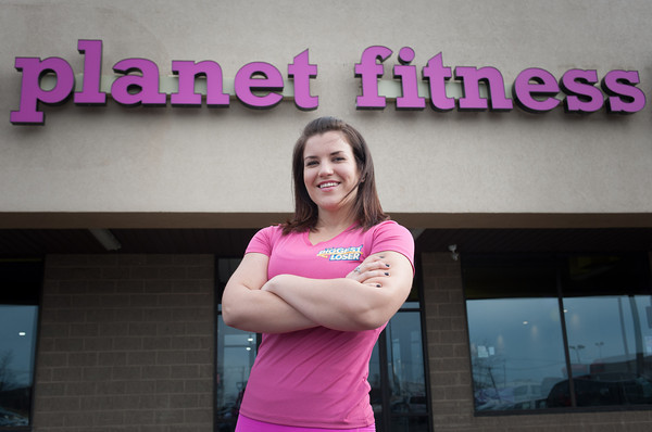 140112 Planet Fitness JOED VIERA/STAFF PHOTOGRAPHER Lockport,NY- Danni Allen wInner of the biggest loser oustide of Planet Fitness during the gyms grand opening on Monday.