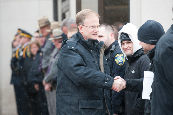 131230 Cop Retirement JOED VIERA/STAFF PHOTOGRAPHER Lockport, NY-Lockport Police Department Lieutenant Scott Seekins shakes hands with Neil Merritt during the ceremony at Lockport Police Headquarters on Monday Dec 30th, 2013.