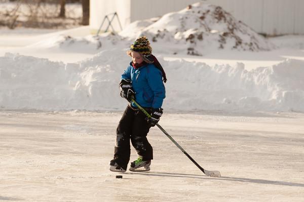 140103 Skating JOED VIERA/STAFF PHOTOGRAPHER Olcott,NY-Andrew Martin plays hockey on the ice patch at Krull park Friday Jan 2nd, 2013..
