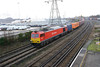 17 January 2014 :: At the appropriate moment the skies darkened and rain started as 60015 eases away from Southampton Western Docks with 6B44 to Eastleigh
