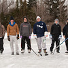 140108 Hockey JOED VIERA/STAFF PHOTOGRAPHER Lockport,NY-From left to right: David Craddock, Dante Kinney, Matt Gagliardy, David Poole, Donnie Mullen and Jake Reid pose for a photo on a patch of ice they made into a makeshift hockey rink in front of the Kenan Center on Wednesday.