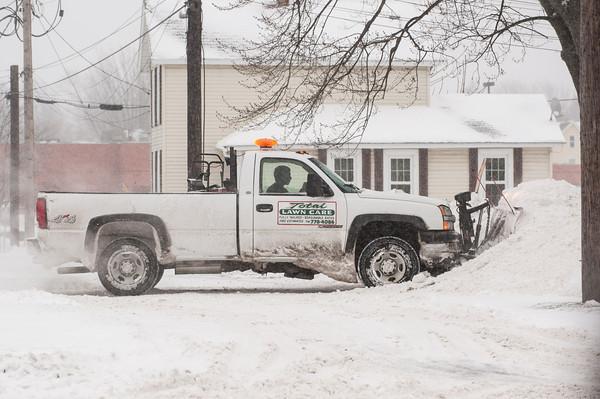 140102 Winter Enterprise JOED VIERA/STAFF PHOTOGRAPHER Lockport, NY-A truck plows snow into a snow bank Thursday Jan 2nd, 2013.