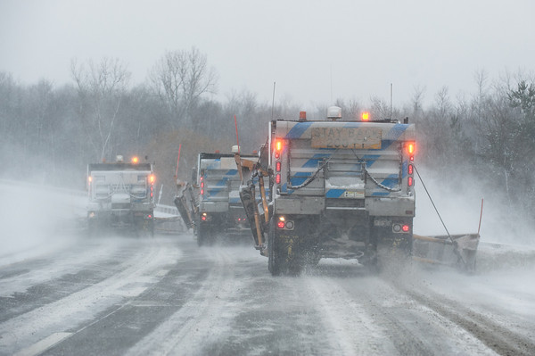 140125 3A Ent JOED VIERA/STAFF PHOTOGRAPHER Getzville, NY- Trucks plow the Lockport expressway on Saturday, January 25th.