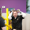 140112 Planet Fitness JOED VIERA/STAFF PHOTOGRAPHER Lockport,NY-A personal trainer shows new members a 30 minute workout during the grand opening of Planet Fitness on Monday.