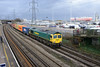 17 January 2014 :: 66591 is pictured passing Millbrook working 4O15 from Hams Hall to Southampton with car carrier mv Toscana also in the picture