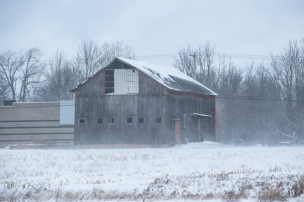 140124 3A JOED VIERA/STAFF PHOTOGRAPHER Lockport,NY-snow blows off the roof of a barn on Transit Road on Friday, January 24th.