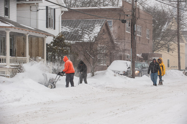 140102 Winter Enterprise JOED VIERA/STAFF PHOTOGRAPHER Lockport, NY-Citizens embrace the snowfall by clearing their driveways and sidewalks Thursday Jan 2nd, 2013.