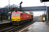 17 January 2014 ::  With rain splashing in the puddles, 60015 races through Redbridge Station on its way from Eastleigh to Fawley (0Z60)