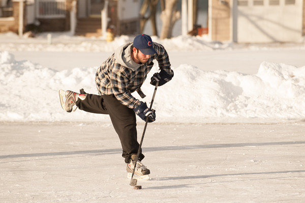 140103 Skating JOED VIERA/STAFF PHOTOGRAPHER Olcott,NY-George Waters plays hockey on the ice patch at Krull park Friday Jan 2nd, 2013..