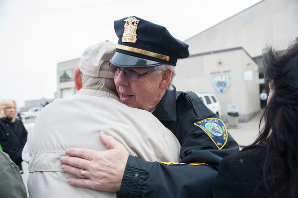 131230 Cop Retirement JOED VIERA/STAFF PHOTOGRAPHER Lockport, NY-Lockport Police Department Captain Rick Podgers hugs his father Richard Podgers Sr. during the ceremony at Lockport Police Headquarters on Monday Dec 30th, 2013.