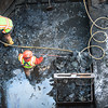140116 Flight of Five JOED VIERA/STAFF PHOTOGRAPHER Lockport,NY- Construction workers clear out wood and shale from an icy section of the     canal's locks on Thursday, January 16th.