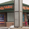 140107 3a Ent JOED VIERA/STAFF PHOTOGRAPHER Lockport,NY-A woman and her child walk into Family Video to rent a movie on Tuesday Jan 7th, 2014. The Polar Vortex caused schools and many local businesses to close.