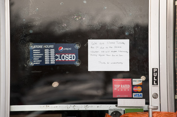 140107 3a Ent JOED VIERA/STAFF PHOTOGRAPHER Lockport,NY-A closed sign is taped on the door outside of Tom's Diner on Tuesday Jan 7th, 2014. The Polar Vortex caused schools and many local businesses to close.