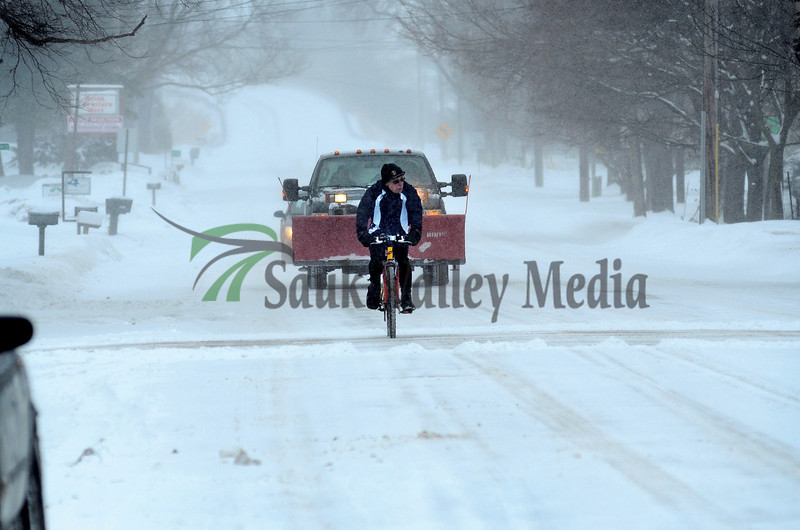 A day better set for snow plows and skis doesn't stop BJ Fenwick from continuing a New Years Day tradition of taking his bicycle out for a ride. A member of the Rock River Valley Bicycle Club, Fenwick was the only one to make the snowy trek around Dixon.